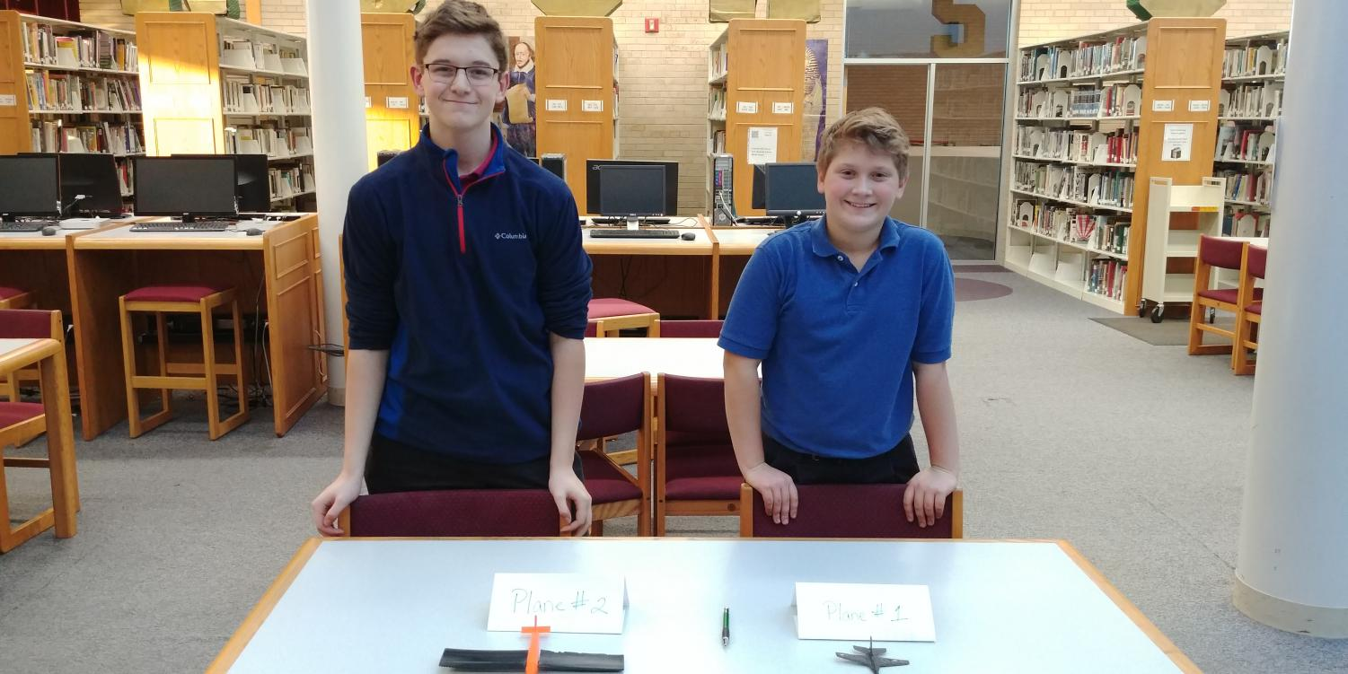 Joe Malo, '21, (left) and Charlie Conley, '21, await judging of their 3-D airplanes Nov. 30.