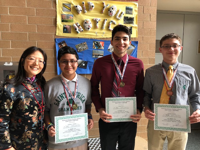 Mrs. Cosentino stands with   Chinese speech medalists Gustavo Azanon, '21,  Ismael Perez, '19 and Dominic Sabella, '20.